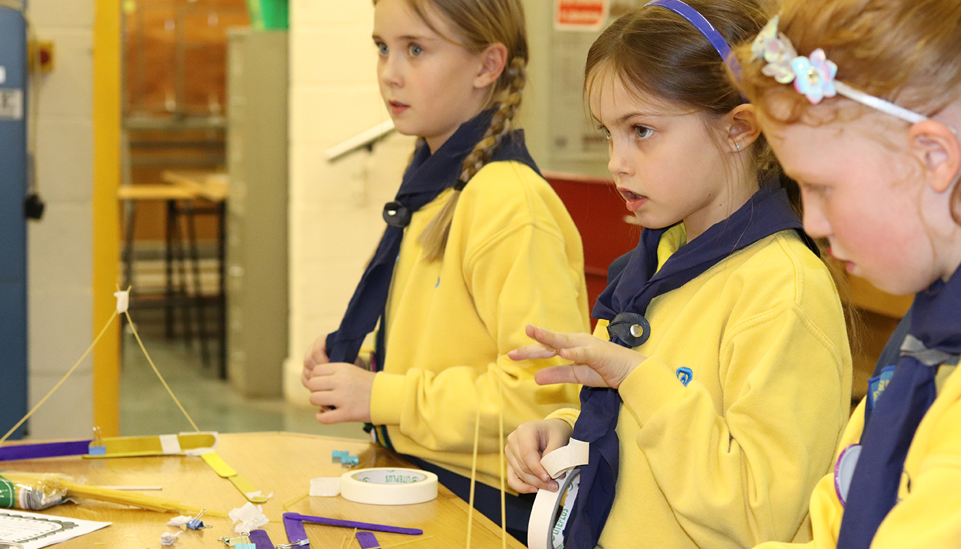 Members of Naomh Bhuite Brownies carrying out STEM Engineering challenges