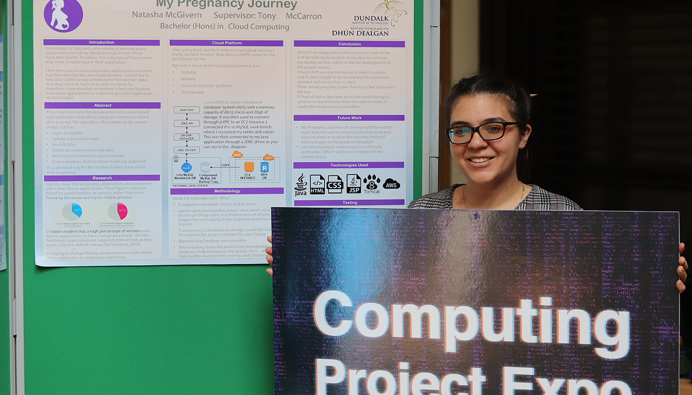 Pictured: Natasha McGivern, Final Year BSc Hons Computing in Cloud Computing student, pictured with a poster presentation of her Pregnancy App