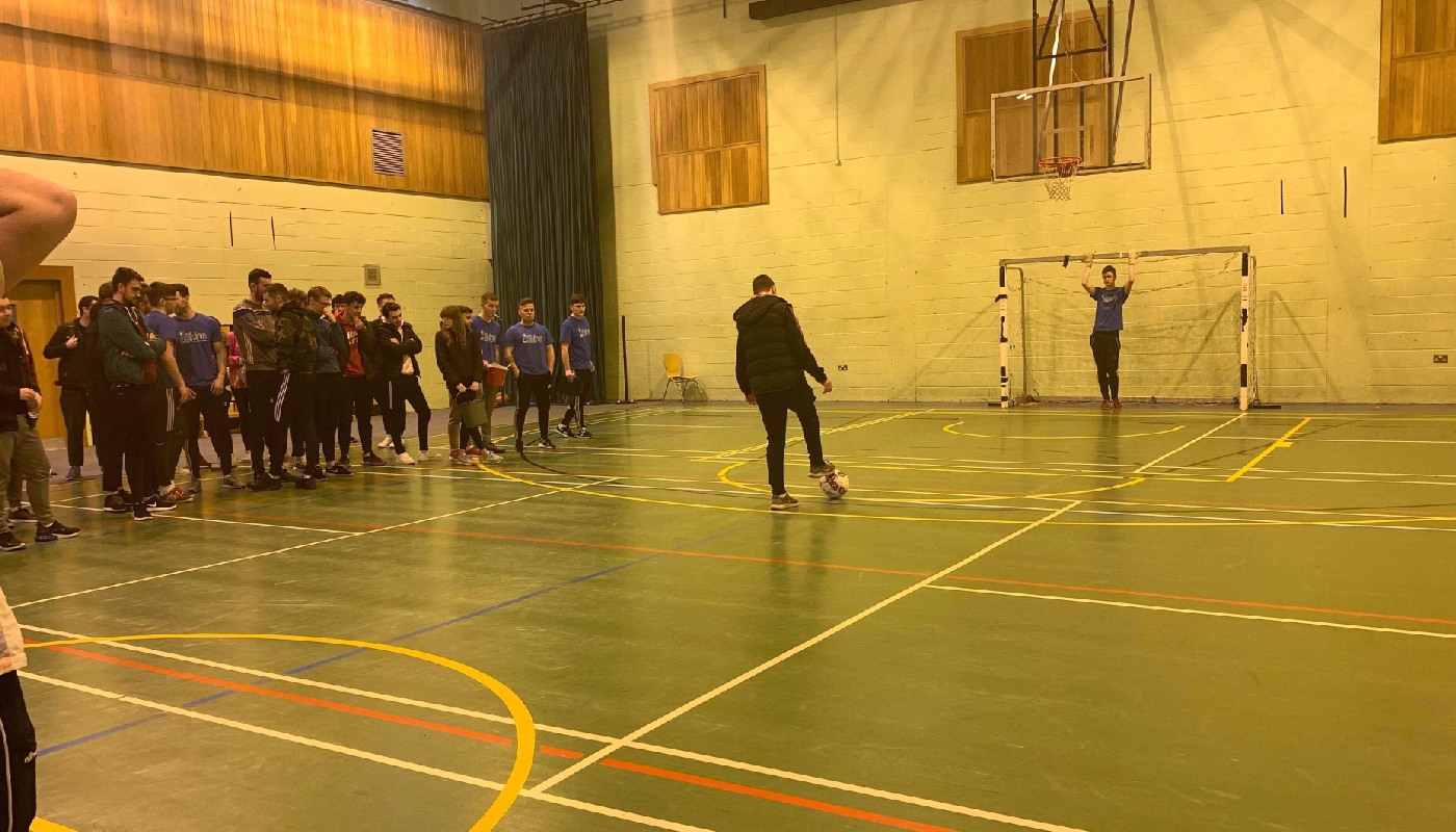 Students taking part in the penalty shootout organised by the class