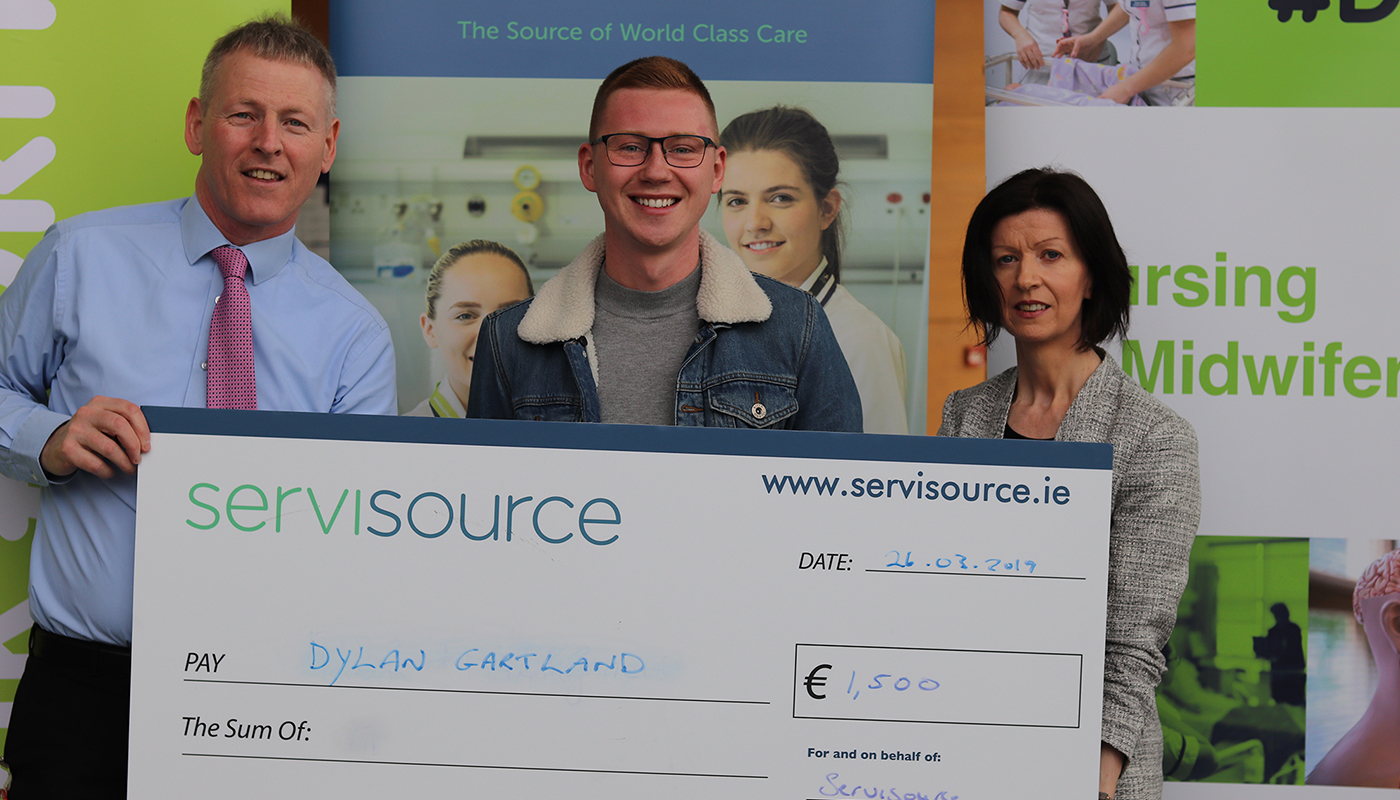 Pictured left to right: Myles Hackett, Head of Department of Nursing, Midwifery and Health Studies at DkIT; Scholarship winner Dylan Gartland, BSc (Hons) in General Nursing student at DkIT and Sinead Kieran, Marketing Manager at Servisource