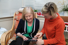 May Nevin, resident of Blackrock County Louth together with Karen Coan of NetwellCASALA using SIMS platform on iPad which was developed by NetwellCASALA as part of the ProACT EC Horizon 2020 project.